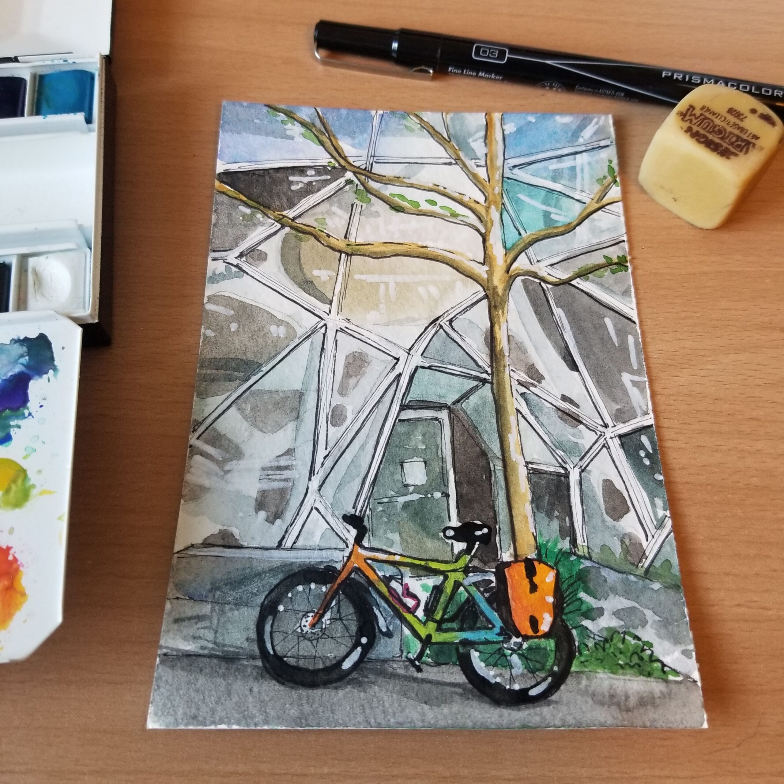 Watercolor postcard featuring a multi-colored commuter bike in front of the Amazon Spheres.